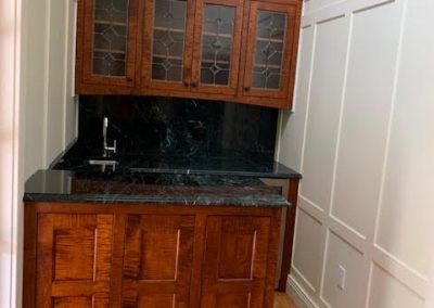 Wood cabinets wtih stone counters